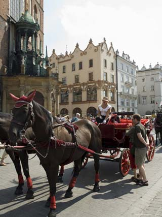 Horse and Carriages in Main Market Square, Old Town District, Unesco World Heritage Site, Poland