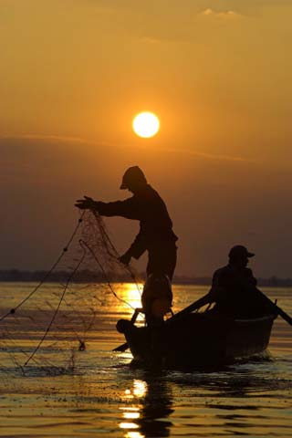 Fishing in the Danube Delta, Casting Nets During Sunset on a Lake, Romania