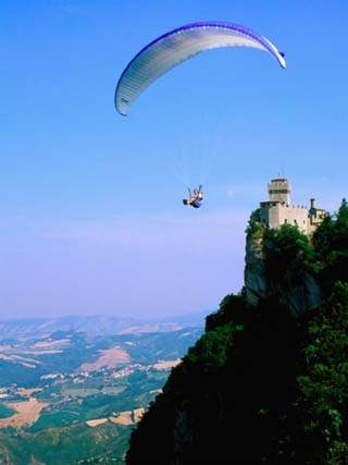 Person Hang-Gliding over Castle with Countryside Beyond, San Marino, San Marino