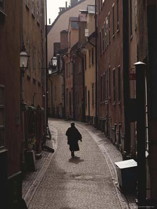Sweden, Stockholm, Woman Walking on Narrow Streets of Gamlestaden, Rear View