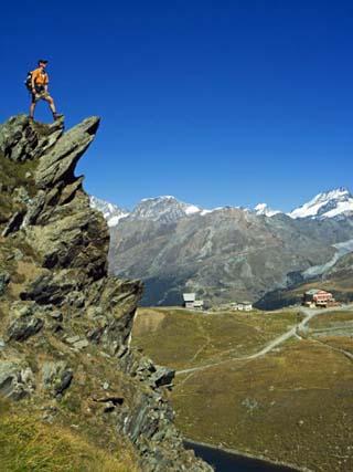 Hiker High on Trail Above Lake at Schwarzee Paradise, Zermatt, Valais, Switzerland