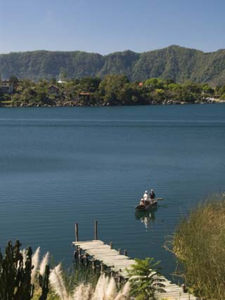 Lake Atitlan With Fishermen in a Small Boat, Near Santiago Atitlan. Guatemala, Central America