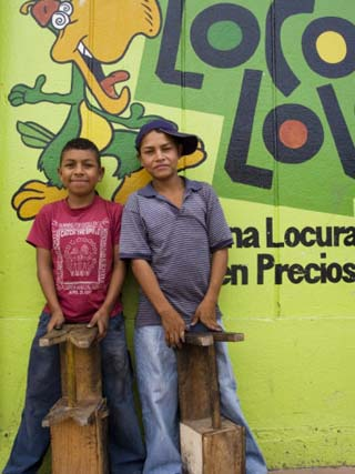 Shoeshine Boys Posing in Front of Colourful Wall, Esteli, Nicaragua