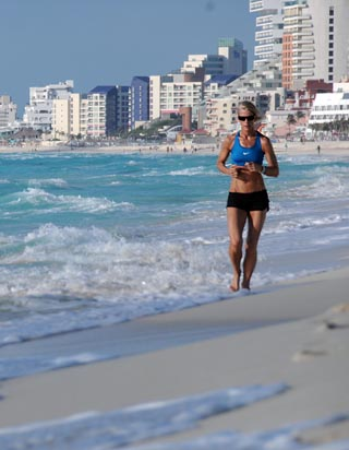 running down the beach in cancun