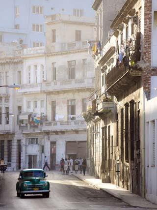 Old American Car Driving Along Quiet Street in Havana Centro, Havana, Cuba