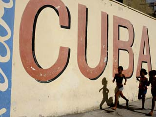 Cuban Girls Run in a Street in Havana, Cuba, Thursday, August 10, 2006