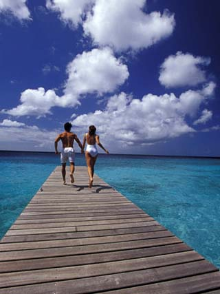 Couple Running on Dock, Curacao, Caribbean