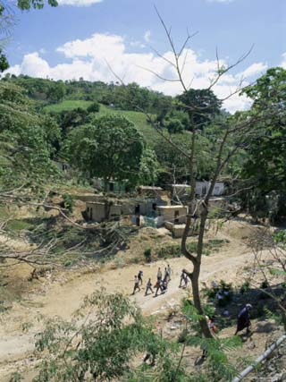 Houses and People Walking in Dry River Bed Caused by Erosion, Near Petionville, Haiti, West Indies