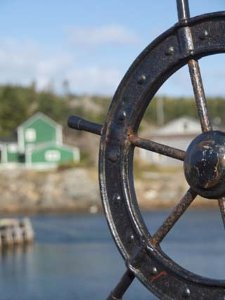 Fisherman's Point, Boat Wheel in Front of Harbor, Twillingate, Newfoundland and Labrador, Canada