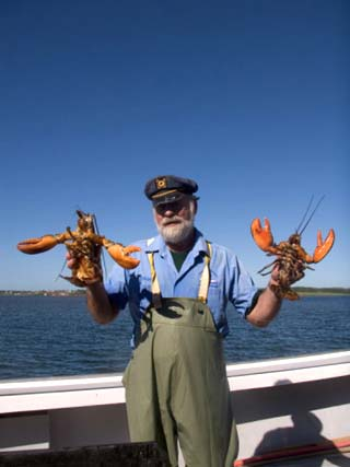 A Fisherman Holds up Two Large Lobster, Charlottetown, Prince Edward Island, Canada