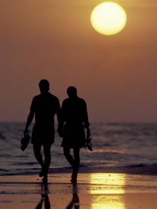 Couple Walking on Beach at Sunset, Sarasota, Florida, USA