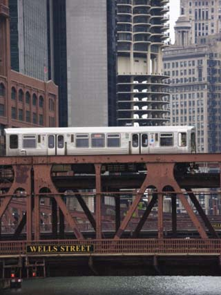 An El Train on the Elevated Train System Crossing Wells Street Bridge, Chicago, Illinois, USA