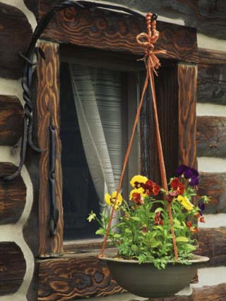 Flower Basket Outside Window of Log Cabin, Fort Boonesborough, Kentucky, USA