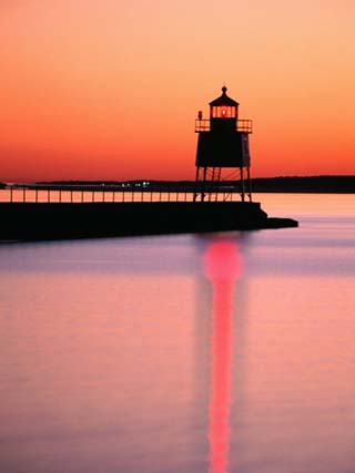 Two Harbors Breakwater Lighthouse Silhouetted at Sunset, Lake Superior, Two Harbours, USA