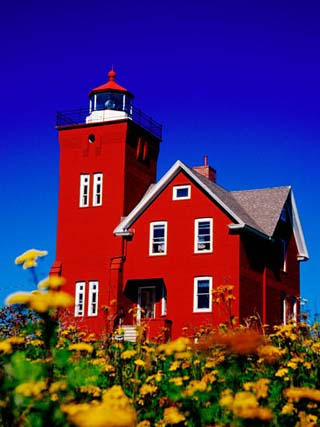 Bright Red Two Harbors Lighthouse with Flowers in Foreground, Lake Superior, Two Harbours, USA