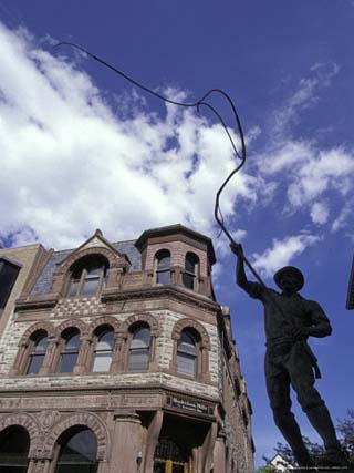 Bullwhacker Statue and Securities Building on Last Chance Gulch, Helena, Montana, USA
