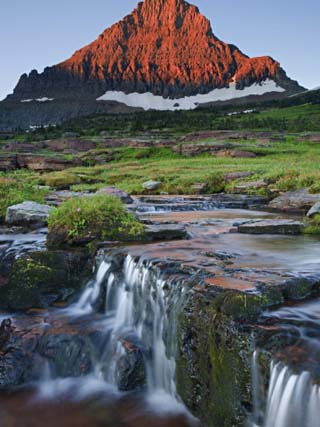 Mount Reynolds in Early Morning Light and a Seasonal Waterfall, Glacier National Park, Montana, USA