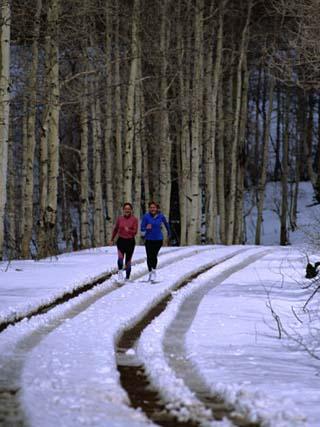Women Jogging in a Wintery Park City, Park City, Utah, USA