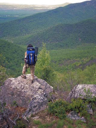 Woman Backpacker Looking at the Valley in Shenandoah National Park