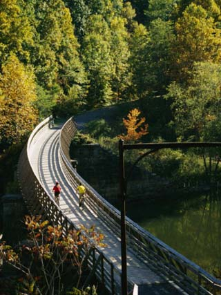 Cyclists Cross a Bridge on the Greenbrier Trail in West Virginia
