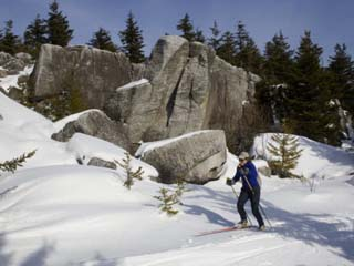 Woman Cross-Country Skiing Past Big Rocks in West Virginia