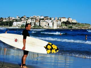 Surfer Carrying Surfboard on Bondi Beach, Sydney, New South Wales, Australia