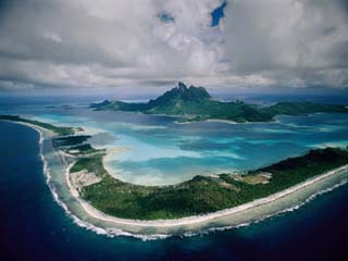 Aerial View of Bora-Bora, its White Beaches Ringed by a Coral Reef