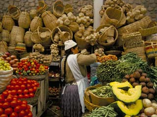 Fruit, Vegetables and Baskets for Sale on Stall in Market, Sucre, Bolivia, South America