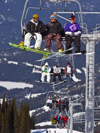 Chairlift Carrying Skiers and Snowboarders, Whistler Blackcomb Ski Resort, British Columbia, Canada