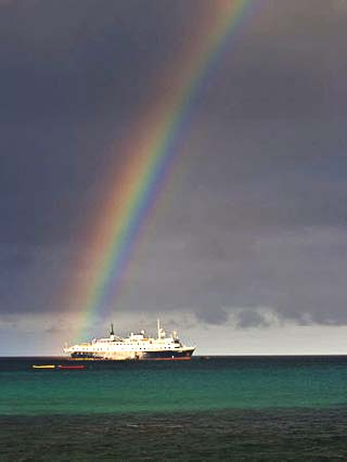Rainbow Shines over the Lindblad Expeditions Ship in the Galapagos