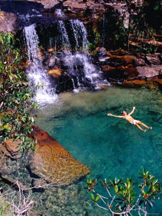 Man Relaxing in Pool at Base of Pacheco Falls, Quebrada Pacheco, Bolivar, Venezuela